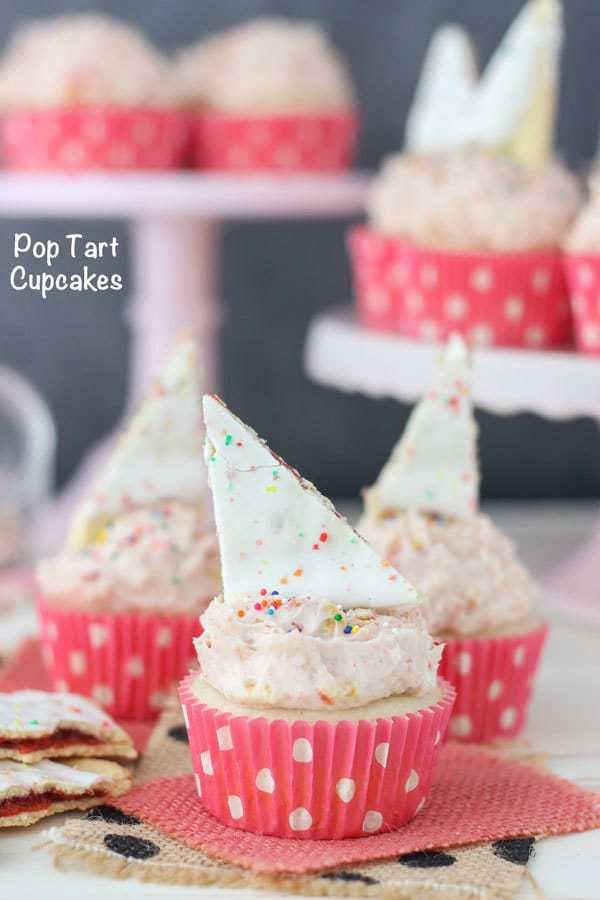 Strawberry Pop Tart Cupcakes. This recipe is a vanilla cupcake with a strawberry jam filling. There are crushed Pop Tart in the frosting too!