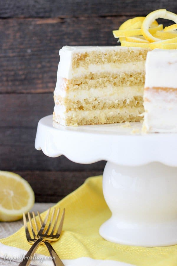 This rich Lemon Olive Oil Cake is covered with a lemon cream cheese whipped cream. The olive oil cake is extra moist and dense in texture. The lightened whipped cream frosting is infused with lemon is the perfect compliment for this cake.