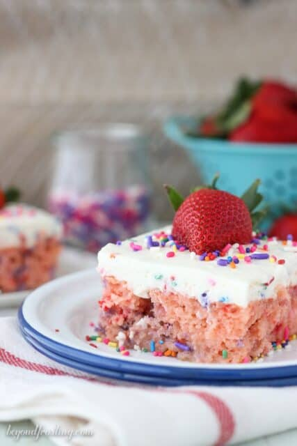 When you marry the flavors of strawberry together with Funfetti, something magical happens. It might just be the sprinkles, but you will have to decide. This Funfetti strawberry poke cake is a strawberry cake with a Funfetti whipped cream