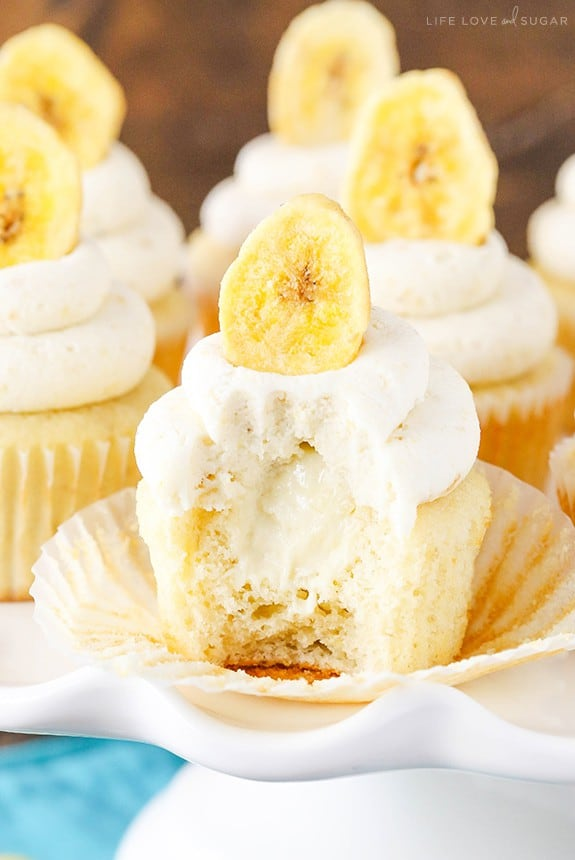 A Banana Cream Pie Cupcake with a Bite Taken Out to Reveal its Gooey Center