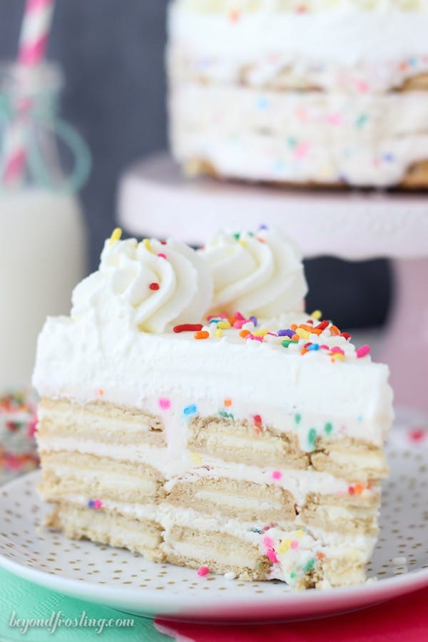 Summertime is not complete with No-Bake Oreo Funfetti Icebox Cake! Layers of Golden Oreos, Funfetti Mousse and whipped cream.