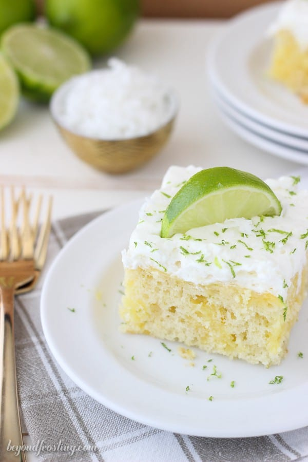Fresh Coconut Lime Poke Cake is a vanilla coconut cake with fresh lime. It's filled with a vanilla pudding and topped with coconut whipped cream. Find the recipe at beyondfrosting.com
