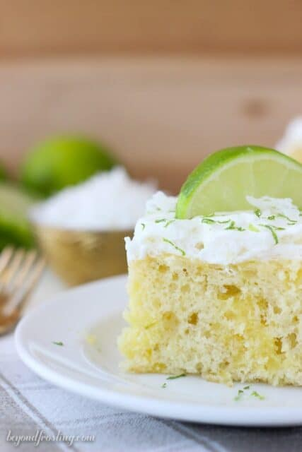 This Coconut Lime Poke Cake is a vanilla cake, with coconut milk, loaded with fresh lime and topped with a coconut whipped cream. It's such a refreshing summer cake!
