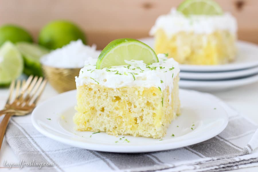 This Coconut Lime Poke Cake is a vanilla cake, filled with vanilla pudding and fresh lime. It's finished off with a coconut whipped cream.