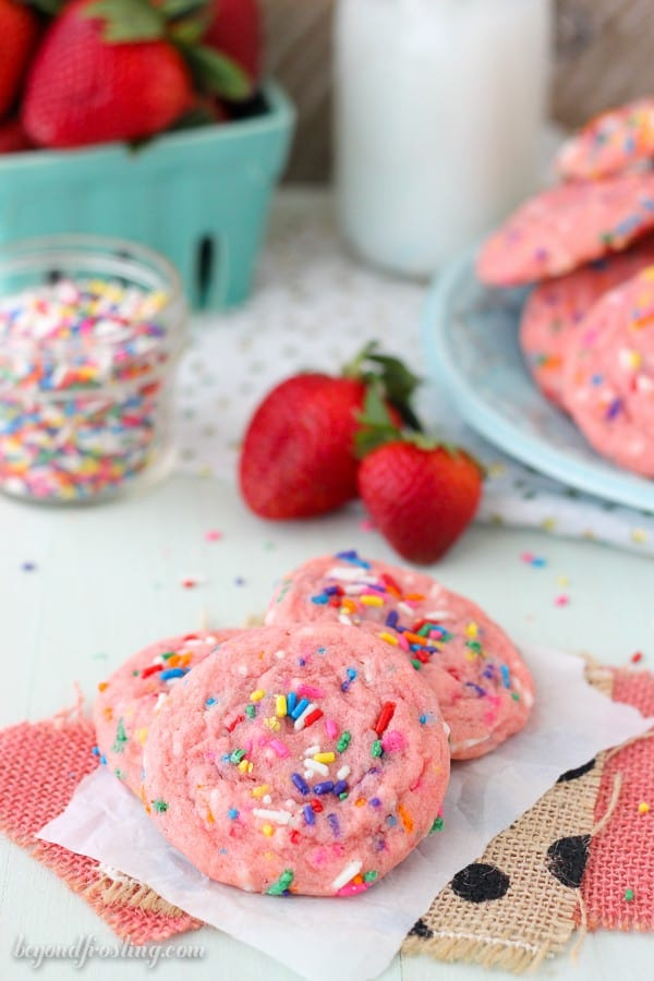 These Strawberry Funfetti Cake Mix Cookies are a chewy strawberry cookie made with cake mix and loaded with sprinkles. These are the perfect summer time cookies!