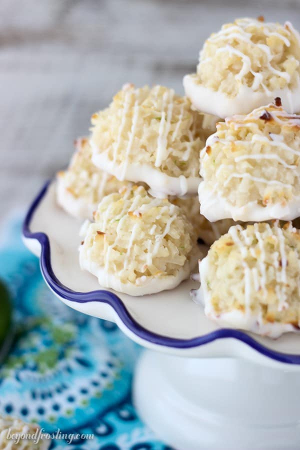 A gooey coconut macaroons infused with lime and dipped in white chocolate. You just need 7 simple ingredients for these, the main ingredients being shredded coconut and sweetened condensed milk and lime.