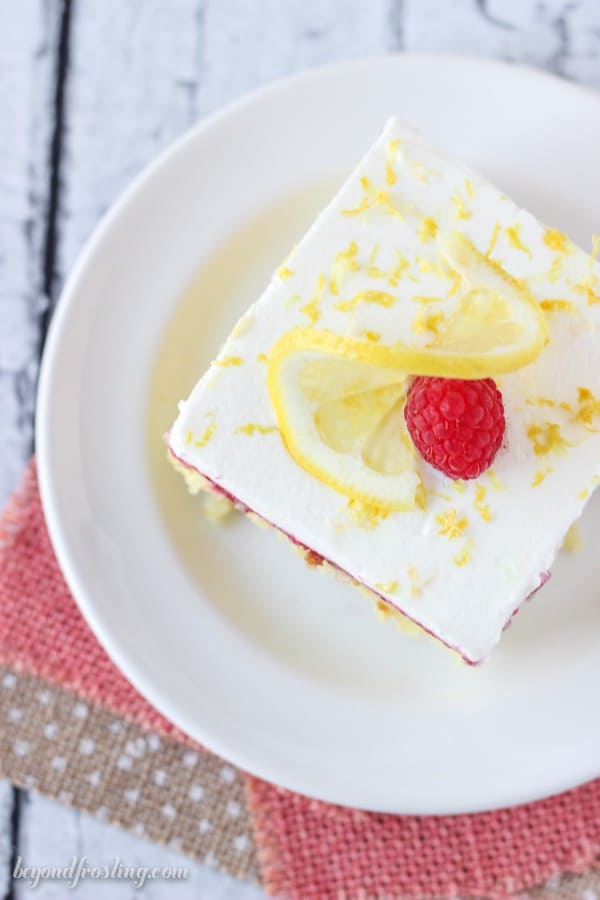 This Lemon Raspberry Poke Cake is an easy lemon cake soaked in sweetened condensed milk, with a fresh tart raspberry sauce and topped with homemade whipped cream. It starts with a vanilla cake mix and a lemon pudding mix. Add some fresh lemon zest to amplify the lemon flavor.