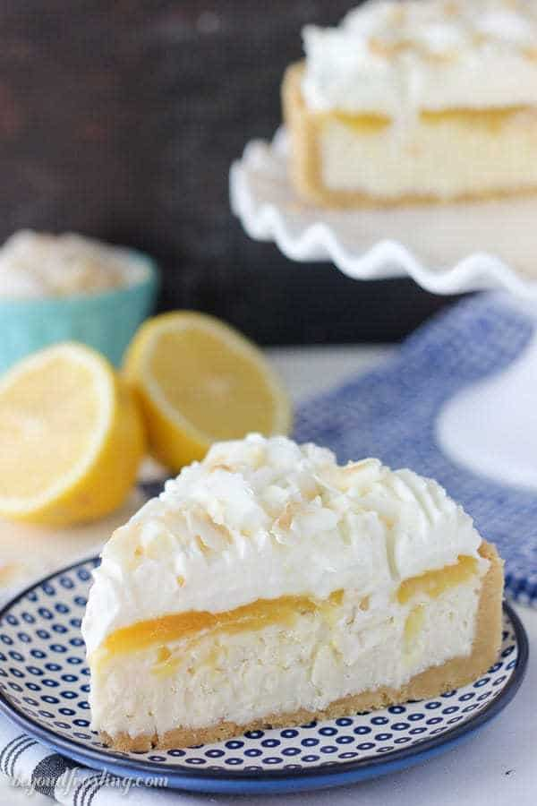 a slice of lemon and coconut cheesecake on a blue polka dot plate