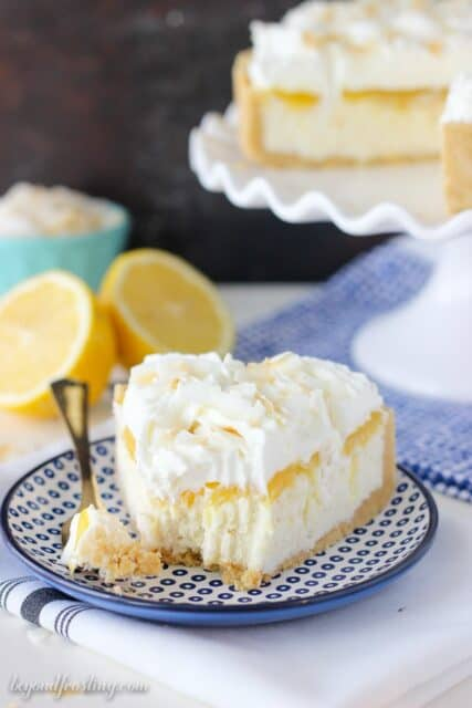 Summertime is the perfect time for no-bake treats! This No-Bake Lemon Macaroon Cheesecake is layered of golden Oreos, coconut cheesecake, lemon curd and whipped cream. Can you say swoon?? Recipe from the No-Bake Treats Cookbook.