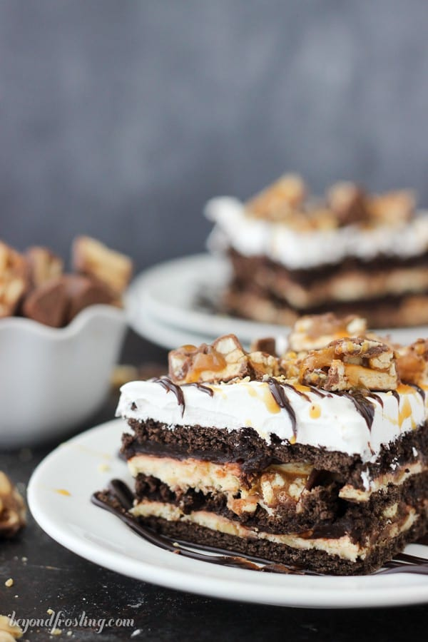 Give your oven a break this summer with this No-Bake Snickers Icebox Cake. Lots of chocolate, caramel and salty peanuts to go around. This easy layer cake has chocolate graham crackers, caramel cream cheese, chocolate pudding and Cool Whip.