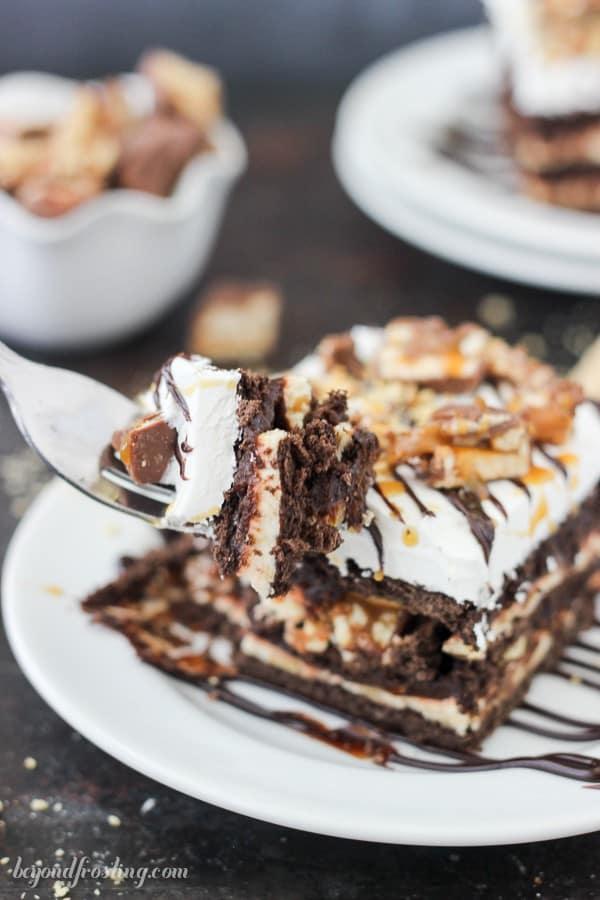 This No-Bake Snickers Icebox Cake is layers of chocolate graham crackers, caramel cream cheese, chocolate pudding, Snickers bars and salty peanuts. There's no need to heat up your kitchen with this dessert.