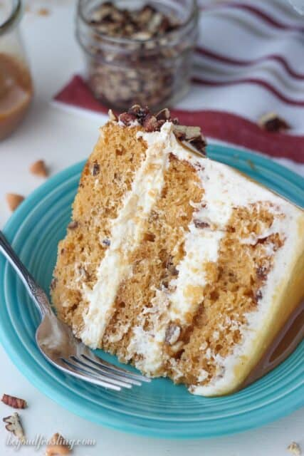 This Salted Caramel Butterscotch cake is one of the best cakes I've ever eaten! The dreamy brown butter frosting is the perfect addition to the rich butterscotch cake. The whole cake is covered with a salted caramel drizzle. You can't deny the salted caramel and butterscotch flavors in this perfect fall inspired cake.