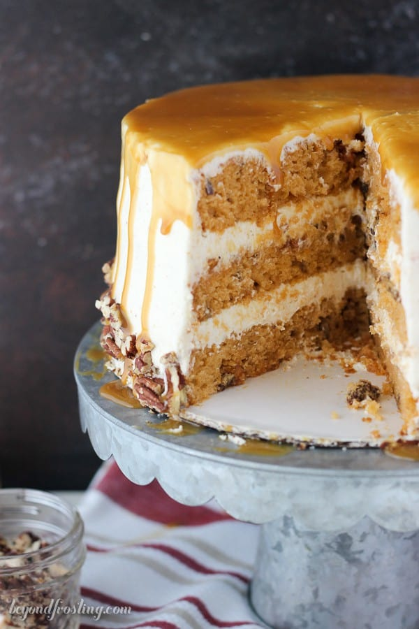 This Salted Caramel Butterscotch cake is a rich butterscotch cake filled with toasted pecans and covered with a brown butter frosting and salted caramel drizzle.