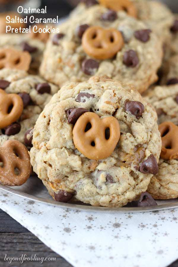 These chunky Oatmeal Salted Caramel Pretzel Cookies are filled with chopped pretzels, chocolate chips, a ribbon of salted caramel and caramel covered pretzels on top.