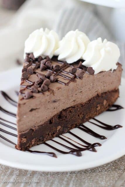 This Brownie Bottom Chocolate Mousse Cake is fudgy brownie is topped with a rich dark chocolate cream cheese mousse and whipped cream. This is the perfect dessert for your favorite chocolate lover.