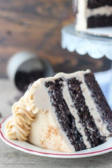 You'll be cutting yourself and extra large slice of this Chocolate Sweet Potato Cake with Cinnamon Brown Sugar Frosting. Three layers of homemade chocolate cake loaded with sweet potato bites. The cake is fluffy and spongy, and a hint of spice. The frosting is to die for and the perfect topping for this cake.
