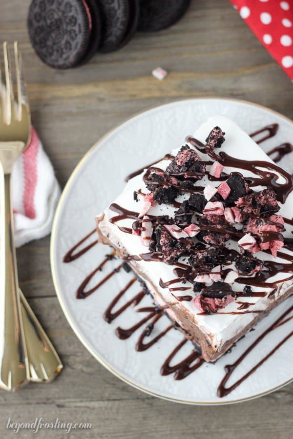 This Peppermint Oreo Lush is a No-Bake layered Icebox Cake. The crust is made with Peppermint Oreo, followed by a no-bake peppermint cheesecake, a chocolate mousse and it's finished with whipped cream.