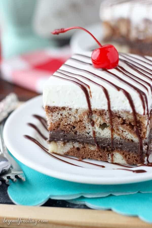 This Root Beer Float Cake is a fun recipe for any time of the year. The cake is a vanilla and chocolate root beer marbled cake with a layer of chocolate cream and a root beer whipped cream.