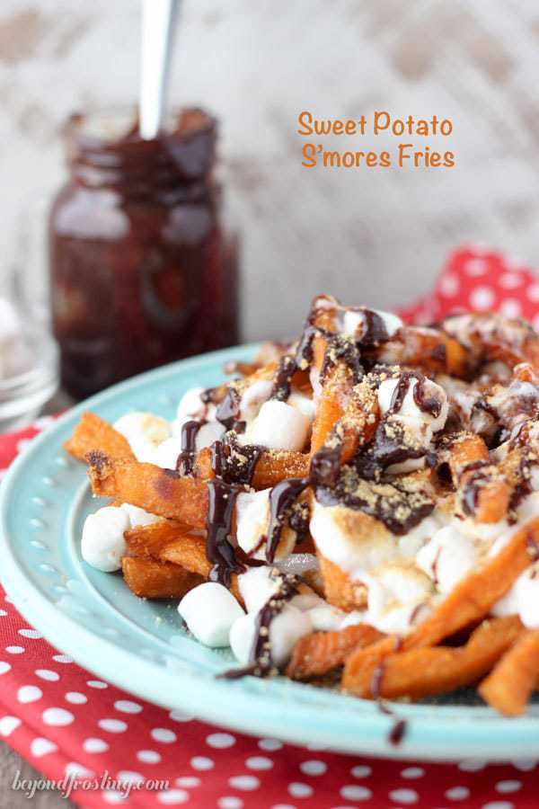 Ooey Gooey Sweet Potato S'mores Fries. Layers of crispy sweet potato fries & melted marshmallow drizzled with chocolate and crushed graham crackers. This sweet potato dessert is perfect for your next party!