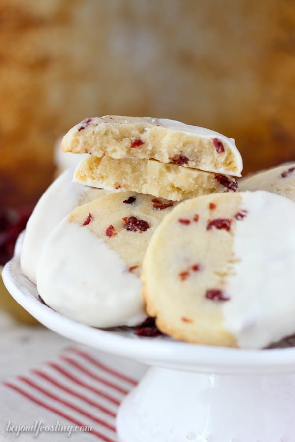 Soft and buttery almond shortbread cookies loaded with sweetened cranberries and dipped in white chocolate.