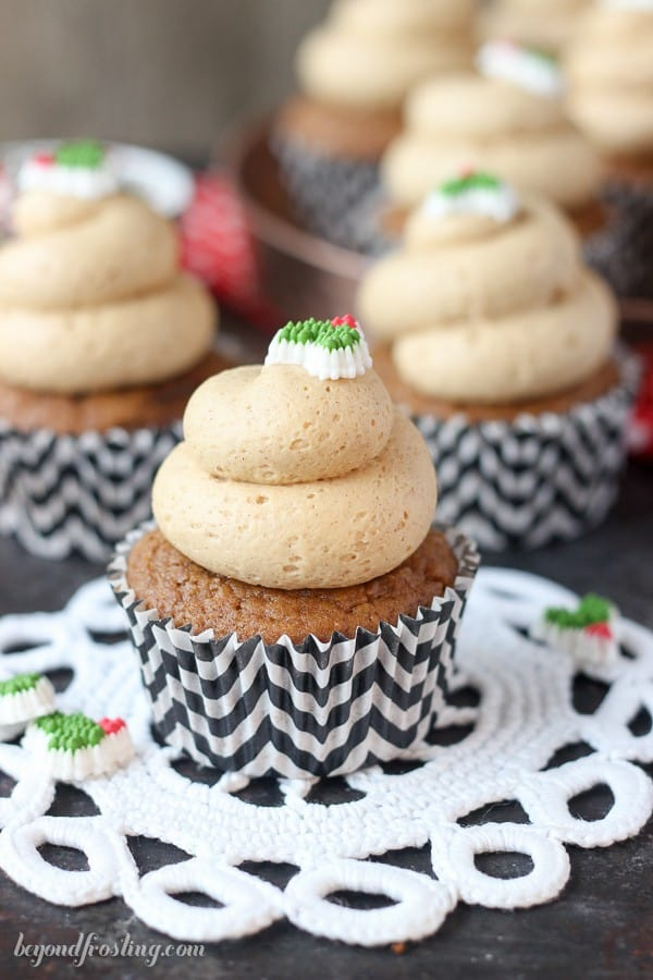 Frosted cupcakes on white doilies.