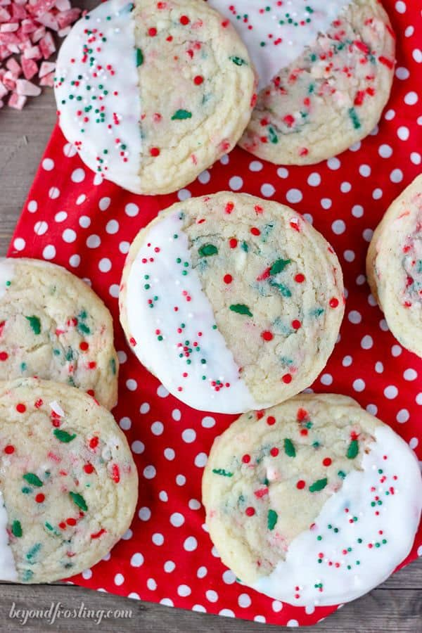 White chocolate dipped chewy sugar cookies with Christmas sprinkles.