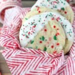 Soft and buttery sugar cookies with a peppermint crunch. These white chocolate dipped peppermint cookies are perfect for the holidays.