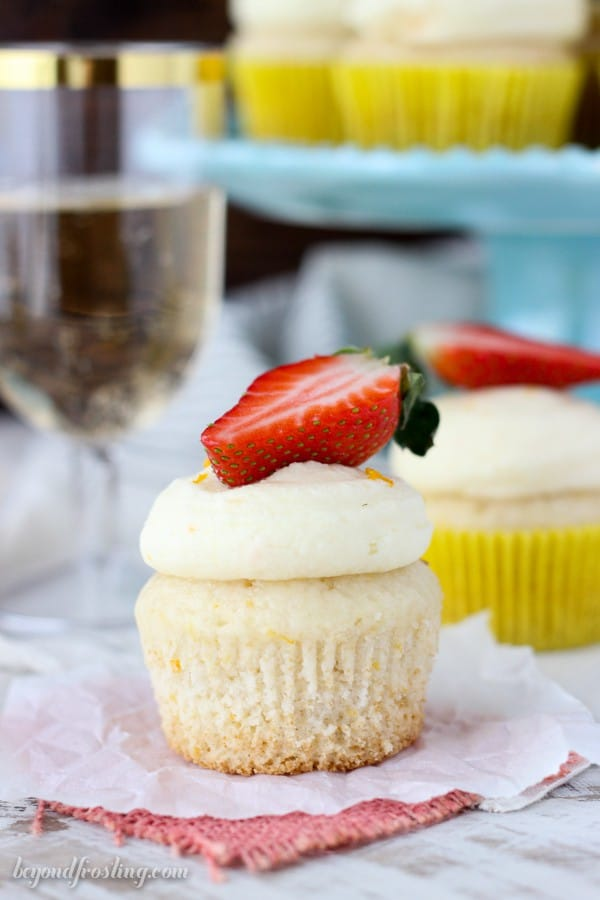These orange infused champagne cupcakes are soaked in a champagne glaze and topped with a orange champagne buttercream. These are easy Mimosa Cupcakes!