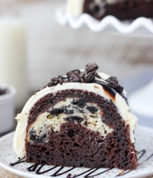 A slice of Chocolate cake with Oreo filling on a white plate