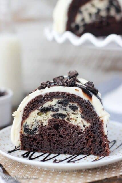 This Oreo Chocolate Cheesecake Cake is a chocolately bundt cake with an Oreo cheesecake filling and it's topped with a cream cheese glaze and more Oreos.