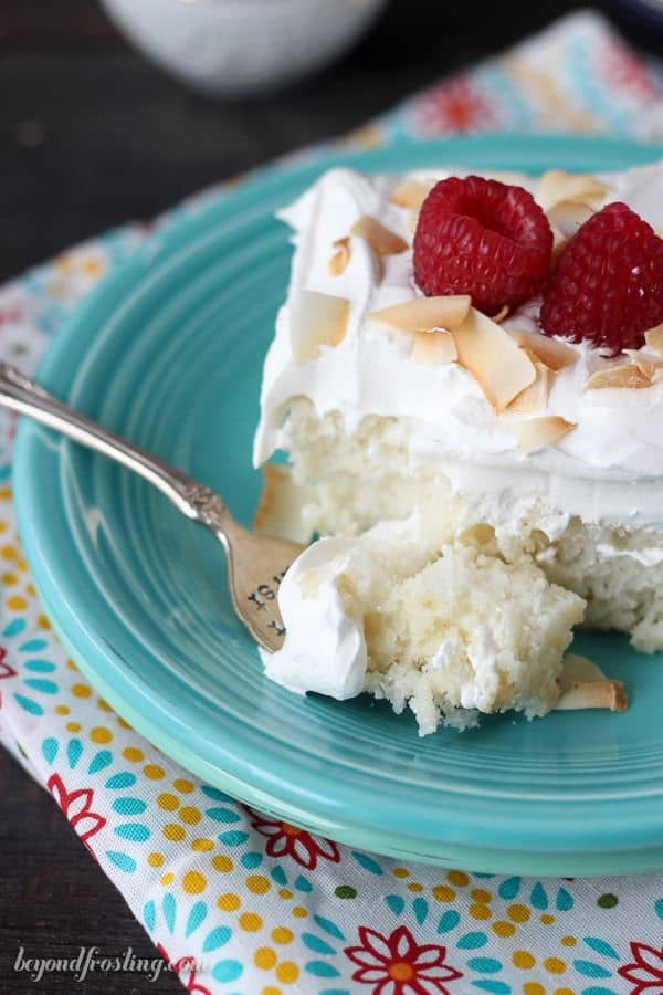This Skinny Coconut Cream Cake is my favorite coconut poke cake but with less calories. The skinnier coconut cake is topped with fat-free sweet milk and a fat-free whipped cream topping.
