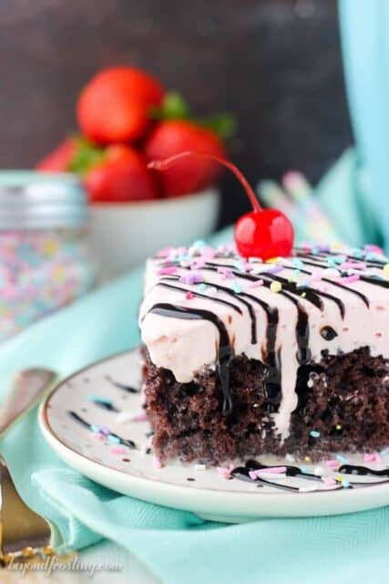 Everybody wants a slice of this Strawberry Milkshake Poke Cake. This chocolate cake is drenched in sweetened condensed milk and topped with a strawberry whipped cream.