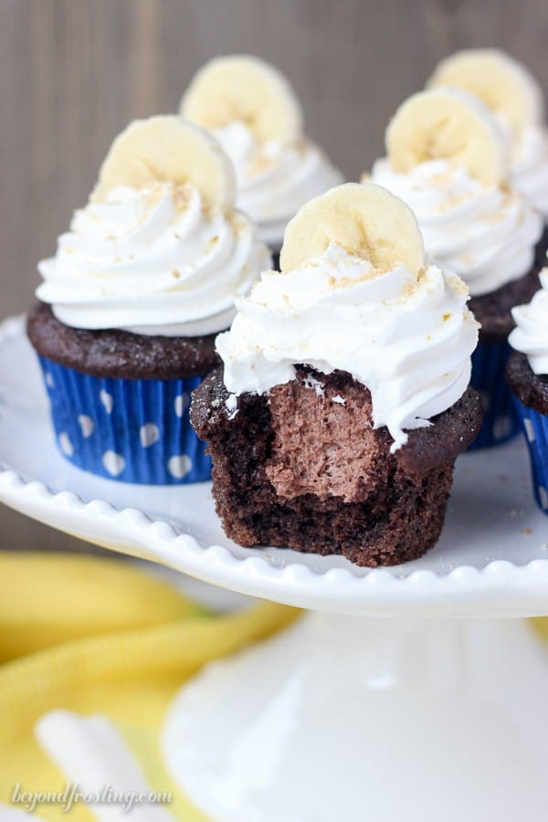 Mouthwatering Chocolate Banana Cupcakes filled with an easy chocolate mousse and topped with whipped cream, bananas and Nilla Wafer. These Chocolate Banana Cream Pie Cupcakes are a show stopper.