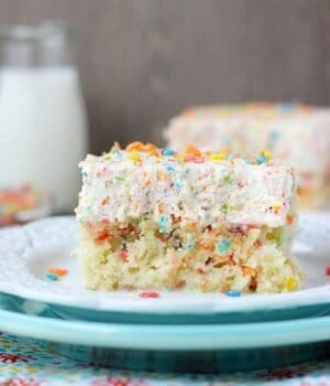 Fruity Pebble Cereal Milk Poke Cake