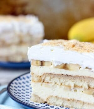This Banana Pudding Tiramisu is layered with the ladyfingers, a thick layer of mousse, fresh sliced banana and repeat. It's topped off with a layer of whipped cream and sprinkled with some Nilla wafer because it wouldn't be banana pudding without Nilla wafers.