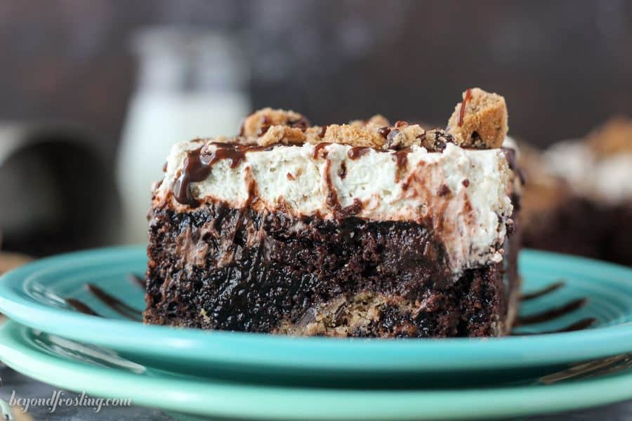 I am drooling over this Chocolate chip cookie poke cake! This chocolate cake has a chocolate chip cookie crust, it's filled with chocolate pudding and topped with a chocolate chip cookie mousse.