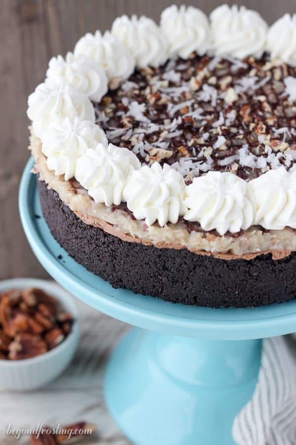 This No-Bake German Chocolate Cheesecake is a triple chocolate cheesecake with a stovetop coconut pecan frosting.