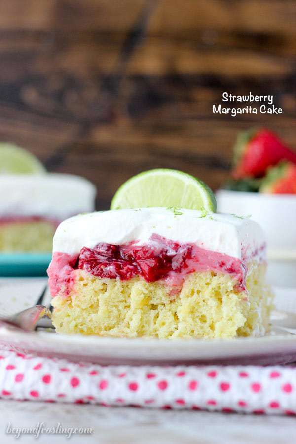This Strawberry Margarita Cake is a lime infused, tequila-spiked cake with a layer of strawberry mousse and it's topped with whipped cream and more lime zest.