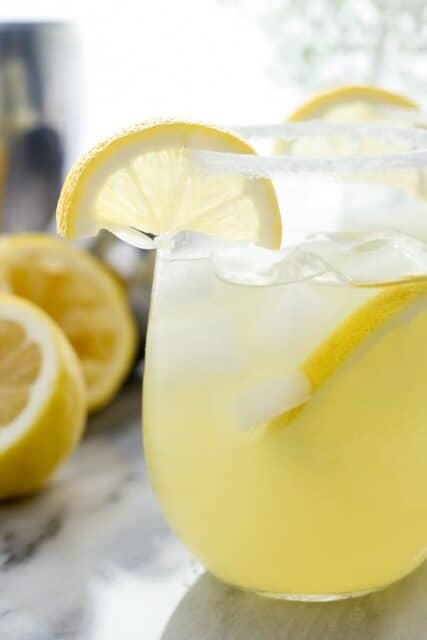 This Tequila Pineapple Punch is perfect for summer! It's made with tequila, coconut rum, pineapple juice a splash of lemon juice and a little seltzer to top it off.