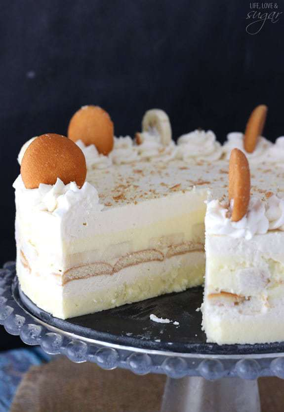 A Banana Pudding Icebox Cake on a Cake Stand with One Slice Removed