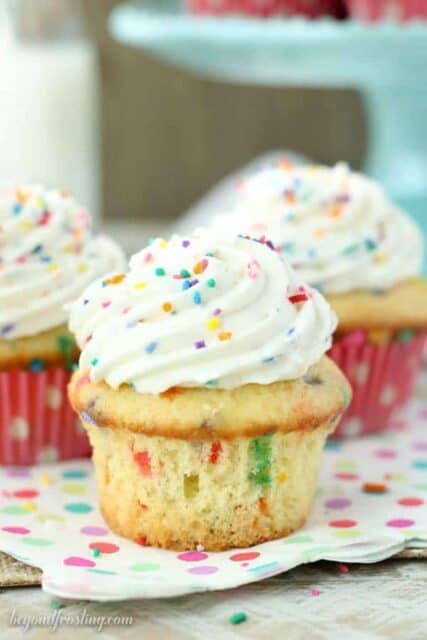Triple Funfetti Cream Pie Cupcakes are the best funfetii cupcakes you'll ever eat. It starts with a vanilla funfetti cupcakes, then it's filled with an easy vanilla mousse. Finally it's topped with a batch of cake batter whipped cream.