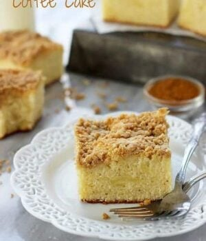 A slice of Eggnog Coffee Cake with a crumbly brown sugar streusel on top resting next to a silver fork.
