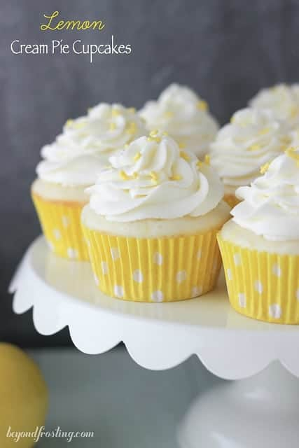 Impress you friends with these luscious Lemon Cream Pie Cupcakes. A fresh vanilla cupcake with a delicate lemon mousse and topped with cream cheese whipped cream.