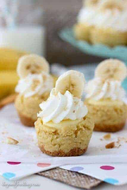 3 Banana Cream Pie Cookie Cups Filled with Banana Cream Mousse and Topped with Whipped Cream and Sliced Bananas