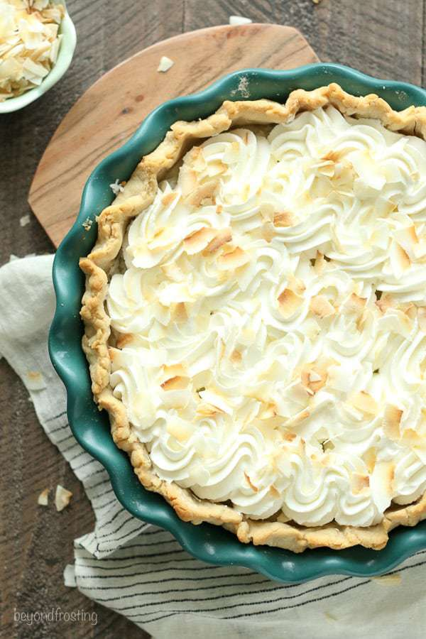 This classic Coconut Cream Pie is made with a sweet coconut custard filled with shredded coconut and it's topped with fresh whipped cream.