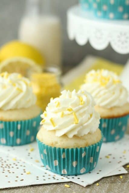 Summer time is calling for Lemon Cream Pie cupcakes. A vanilla cupcake with a delicate lemon mousse and topped with cream cheese whipped cream.