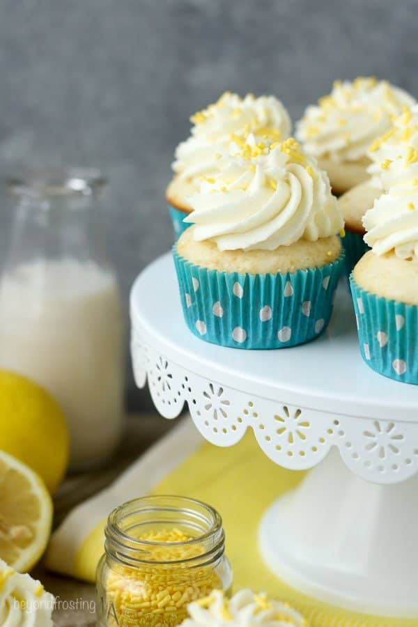 Impress your friends with these luscious Lemon Cream Pie Cupcakes. A fresh vanilla cupcake with a delicate lemon mousse and topped with cream cheese whipped cream.