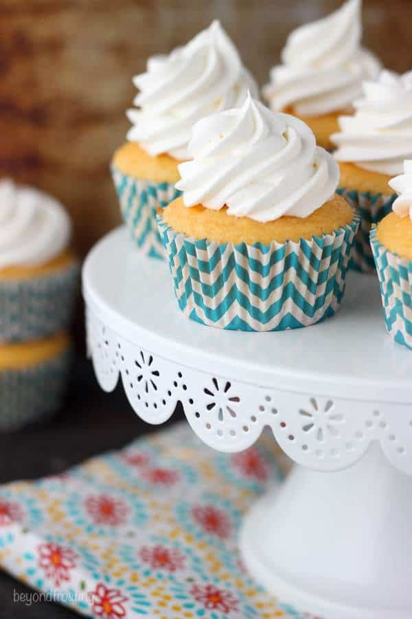 These Skinny Orange Creamsicle Cupcakes are full of flavor but without all the extra calories! The orange flavored cupcake it topped with a fat-free whipped topping.