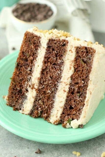 This triple layer Chocolate Zucchini Cake features a delicate chocolate cake stuff with zucchini. It's frosted with a rich brown butter buttercream frosting.
