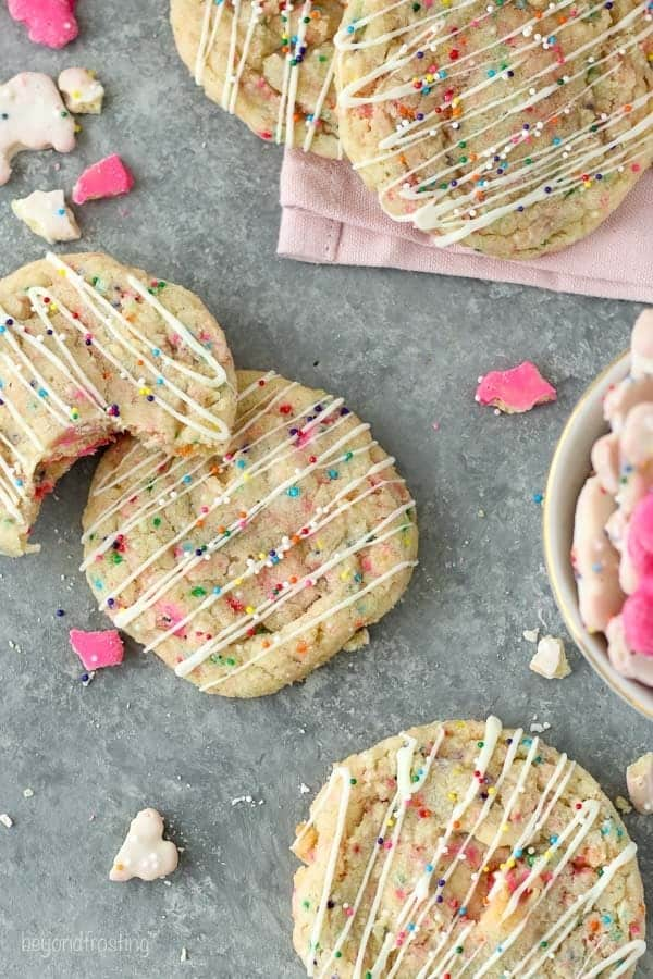These Circus Animal Stuffed Cookies are soft and chewy and filled with frosted circus animal cookies, with a drizzle of white chocolate and sprinkles on top.